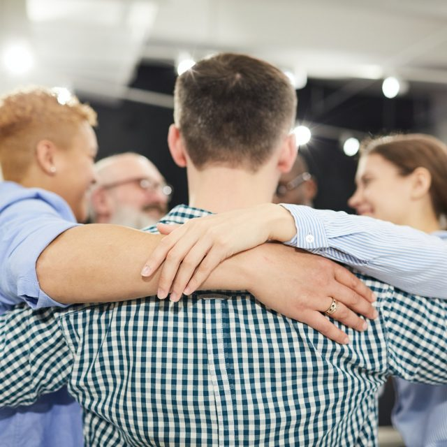Group Hug in Therapy Session
